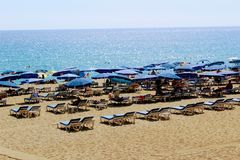 July, 2017 - People rest on deckchairs in the shade of beach umbrellas on Cleopatra Beach Alanya, Turkey Royalty Free Stock Photo