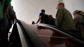 20 July 2017. Russia. The Moscow subway. Passengers riding the escalator. 20 July 2017. Russia. The Moscow subway. Passengers riding the escalator stock video