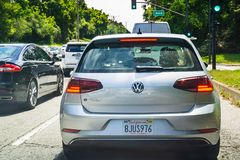 July 4, 2019 San Francisco / CA / USA - Back view of Volkswagen e-Golf driving on a busy the city street; VW e-Golf is the