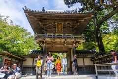 Tourists coming out of the main entrance to The Japanese Tea Garden in Golden Gate Park. July 20, 2018 San Francisco / CA / USA - Tourists coming out of the main royalty free stock image