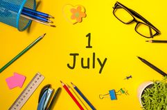 July 1st. Image of july 1, calendar on yellow background with office supplies. Summer time Royalty Free Stock Photography
