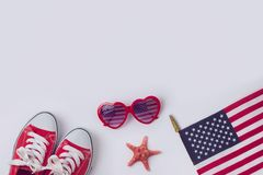July 4th concept. Independence day celebration with USA flag, sunglasses and sneakers.View from above. Flat lay stock photo