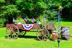 July 4th Landscape. Antique wagon decorated for the 4th of July stock images