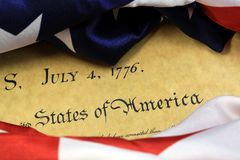 July 4th, 1776 - United States Bill of Rights. Preamble to the Constitution of the United States and American Flag Stock Photo