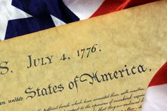July 4th, 1776 - United States Bill of Rights. Preamble to the Constitution of the United States and American Flag Stock Photography