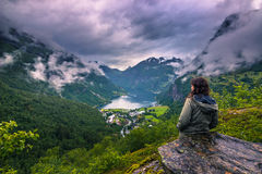 July 24, 2015: Traveller beholding the Geirangerfjord, world her. July 24, 2015: A traveller beholding the Geirangerfjord, world heritage site, Norway Stock Photos