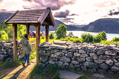 July 23, 2015: Traveller at the entrance to Urnes Stave Church, Royalty Free Stock Photography