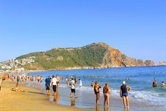 July, 2017 - Vacationers bathe in the sea and sunbathe in the sun on Cleopatra Beach Alanya, Turkey.  Stock Images
