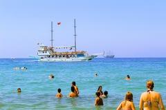 July, 2017 - Vacationers bathe in the sea and sunbathe in the sun on Cleopatra Beach Alanya, Turkey.  Royalty Free Stock Photo