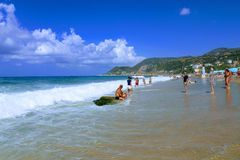 July, 2017 - Vacationers bathe in the sea and sunbathe in the sun on Cleopatra Beach Alanya, Turkey.  Royalty Free Stock Image