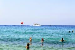 July, 2017 - Vacationers bathe in the sea and sunbathe in the sun on Cleopatra Beach Alanya, Turkey.  Stock Photo