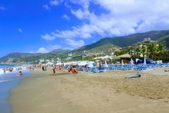 July, 2017 - Vacationers bathe in the sea and sunbathe in the sun on Cleopatra Beach Alanya, Turkey Stock Photos