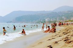 July, 2017 - Vacationers bathe in the sea and sunbathe in the sun on Cleopatra Beach Alanya, Turkey Stock Images