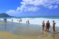 July, 2017 - Vacationers bathe in the sea and sunbathe in the sun on Cleopatra Beach Alanya, Turkey Royalty Free Stock Photography