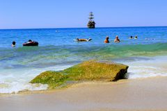 July, 2017 - Vacationers bathe in the sea and sunbathe in the sun on Cleopatra Beach Alanya, Turkey Stock Image