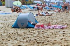 July, 2017 - Vacationers bathe in the sea and sunbathe in the sun on Cleopatra Beach Alanya, Turkey Royalty Free Stock Photo