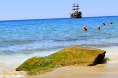 July, 2017 - Vacationers bathe in the sea and sunbathe in the sun on Cleopatra Beach Alanya, Turkey Royalty Free Stock Photos