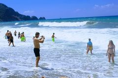 July, 2017 - Vacationers bathe in the sea and sunbathe in the sun on Cleopatra Beach Alanya, Turkey Stock Photography