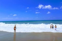 July, 2017 - Vacationers bathe in the sea and sunbathe in the sun on Cleopatra Beach Alanya, Turkey Royalty Free Stock Image