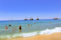 July, 2017 - Vacationers bathe in the sea and sunbathe in the sun on Cleopatra Beach Alanya, Turkey Royalty Free Stock Images