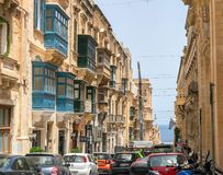Ancient Balconies in Valletta, Malta. 14 July 2018 - Valletta, Malta. Ancient, colorful wooden balconies overview narrow lower street of Valletta, capital of Royalty Free Stock Photo
