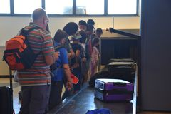 2016 July Verona Italy -  Tourists expect luggage on the conveyor for suitcases Stock Images