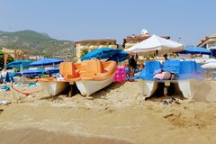 July, 2017 - Walking pedal catamarans lie on the sand of Cleopatra Beach Alanya, Turkey.  Stock Photos