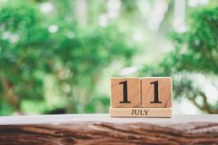 July 11  wooden calendar on vintage wood abstract background. world population day  with copy space for your text. July 11 wooden calendar on vintage wood royalty free stock image
