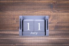11 July World Population Day. Wooden, square calendar. business trip or holiday planning background Royalty Free Stock Images