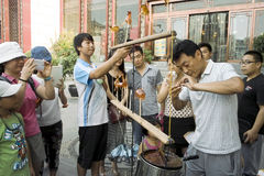 On July 31, 2014 in xi 'an wild goose pagoda scenic area in the square, a folk artists intently rub blowing the calf, lamb, small Stock Photography