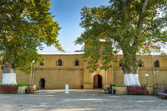 Juma Mosque in Derbent. Juma Mosque - the most ancient mosque in Russia. Old trees Platanus orientalis in the yard. Derbent. Republic of Dagestan, Russia royalty free stock photography