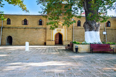 Juma Mosque in Derbent. Juma Mosque - the most ancient mosque in Russia. Old trees Platanus orientalis in the yard. Derbent. Republic of Dagestan, Russia stock photography