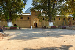 Juma Mosque in Derbent. Juma Mosque - the most ancient mosque in Russia. Old trees Platanus orientalis in the yard. Derbent. Republic of Dagestan, Russia royalty free stock image
