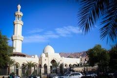 Juma Mosque view in Aqaba, Jordan. Juma Mosque view in Aqaba with landscape of sandy mountains, Middle East, Jordan stock photos