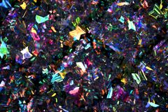 Jumble των πολύχρωμων πλαστικών πεταλούδων στοκ φωτογραφία