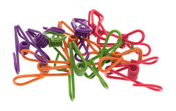 Jumble of colorful wire clips isolated on white background Royalty Free Stock Photography