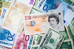 A jumble of currency Stock Photos