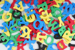 Jumble of foamed rubber letters Stock Images