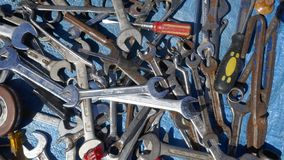 Jumble of old rusty hand tools. Old rusty messy hand tools.  royalty free stock photo
