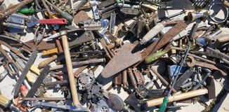Jumble of old rusty hand tools. Old rusty messy hand tools.  stock photo