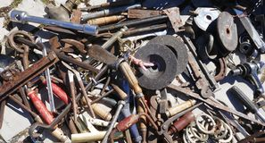 Jumble of old rusty nails and hand tools. Old rusty messy hand tools stock images