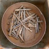 Jumble of old rusty nails and hand tools. Old rusty messy hand tools.  royalty free stock photo