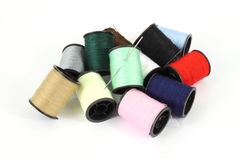 Jumble of spools of thread and sewing needle Royalty Free Stock Photography