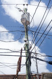 Jumble of wires on power pole Stock Photo