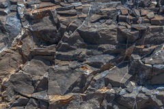 Jumbled Black Rock Wall Background Royalty Free Stock Photography