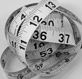 Jumbled tape measure. Tape measure jumbled in a ball Royalty Free Stock Photos