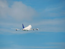 Jumbo airplane is taking off into a blue sky. Jumbo aircraft is taking off into a blue sky Stock Image