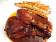 Jumbo Barbecue Chicken Drumsticks and Fries Royalty Free Stock Photography