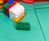 Jumbo building blocks on leather mat for fun playtime. Creative stacking toy for kids royalty free stock photo