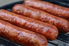 Jumbo hotdogs cooking Stock Photography